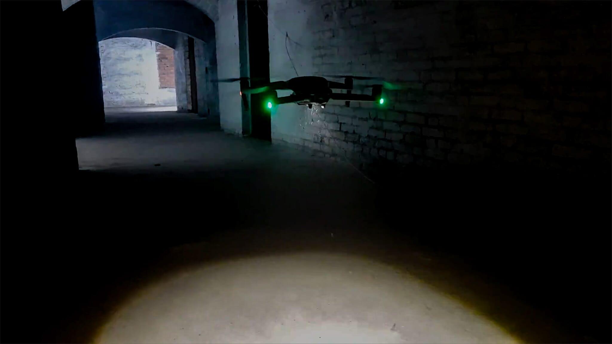 Mavic 2 drone flying in a dark tunnel